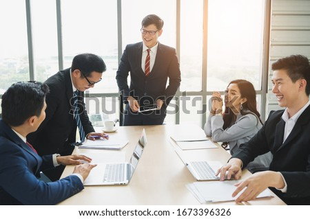 Asian business people team analyzing statistics financial. Team of businesspeople Meeting Conference Discussion Corporate Concept in office. #1673396326