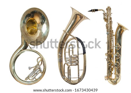 set of three wind musical instruments, classic wind instrument sousaphone, classic wind musical instrument saxophone and baritone Euphonium, isolated on a white background Royalty-Free Stock Photo #1673430439