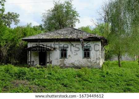 An old abandoned house in one of the Ukrainian villages. Scenery. #1673449612