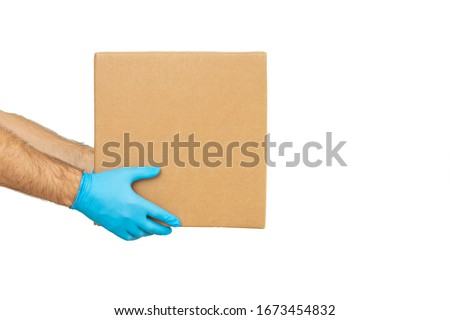 Delivery man holding cardboard boxes in rubber gloves / copy space. Fast and free Delivery transport . Online shopping and Express delivery  #1673454832