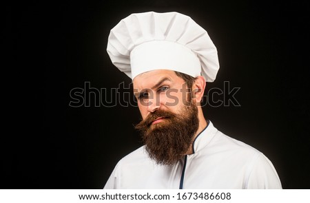 Bearded chef, cooks or baker. Bearded male chefs isolated on black. Cook hat. Confident bearded male chef in white uniform. Serious cook in white uniform, chef hat. Portrait of a serious chef cook. #1673486608