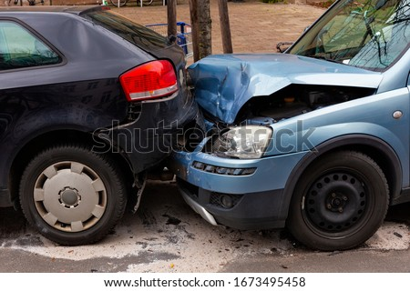 Two cars with metal damage after a rear-end collision Royalty-Free Stock Photo #1673495458