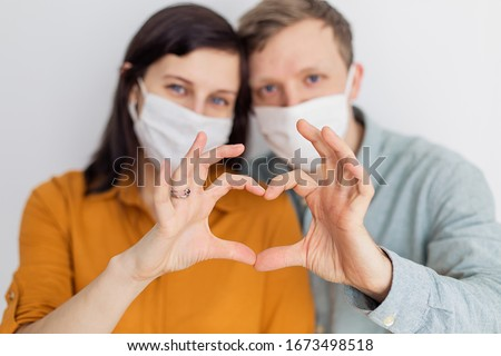 Love story family husband wife boyfriend girlfriend quarantined. Normal life with coronavirus. Lifestyle COVID-19. Quarantine virus protection sterility  home together  heart symbol #1673498518