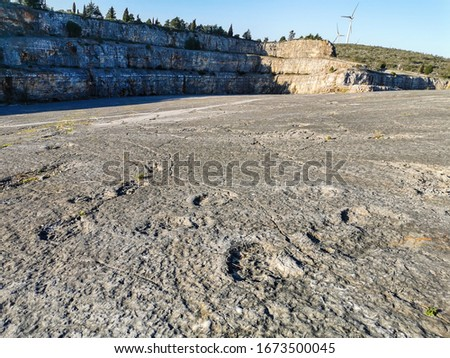 Natural monument of fossil dinosaur footprints in Serra D 'Aire in Pedreira do Galinha, in Portugal. A pedagogical circuit was created at the site, where visitors can see and touch the footprints