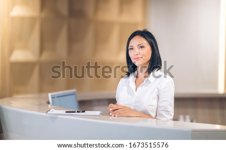 female receptionist at counter in hotel