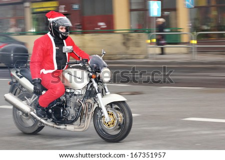 GDYNIA, POLAND - DECEMBER 15: Santas participate in the International Santa Claus motorcycle parade on Dec.15, 2013 in Gdynia, Poland. They stop in the City center and give charity gifts for children #167351957