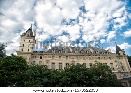 Palace in Paris France. Old building on cloudy sky. Classic architecture. Architectural style. Building and construction. Building architecture. Building open to nature. Sightseeing. Summer vacation. #1673522833