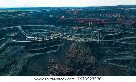 Aerial view of the Iron ore mining, Panorama of an open-cast mine extracting iron ore, preparing for blasting in a quarry mining iron ore, Explosive works on open pit #1673523928