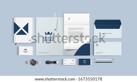 Stationery design mock up set for corporate identity or branding. Dark blue color style and grey background. Realistic top view corporate style set. Royalty-Free Stock Photo #1673550178