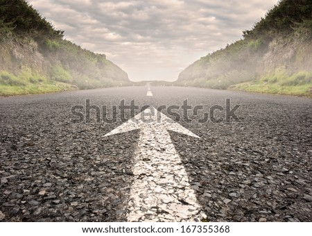 arrow on asphalt road to the horizon Royalty-Free Stock Photo #167355368
