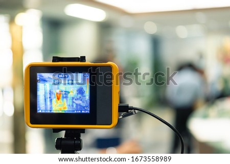 Asian people waiting for body temperature check before access to building for against epidemic flu covid19 or corona virus from wuhan in office by thermoscan or infrared thermal camera #1673558989