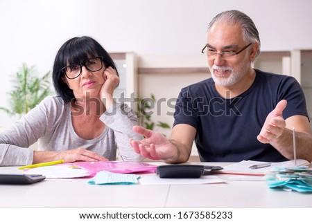 Senior couple discussing financial plans #1673585233