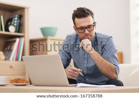 Busy man working at home Royalty-Free Stock Photo #167358788
