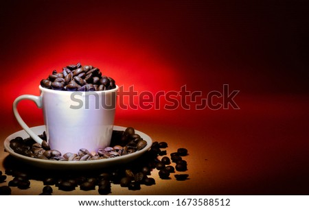 cup filled coffee beans with creative background with light rays,light painting photography technique