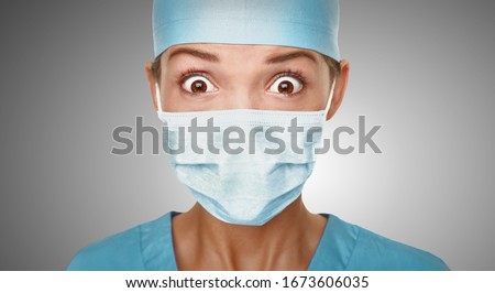 Virus scare Asian doctor woman shocked wearing coronavirus mask protection looking scared. China hospital staff. #1673606035
