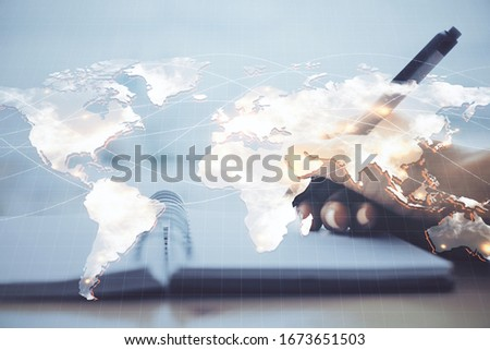 International business hologram over woman's hands taking notes background. Concept of success. Double exposure #1673651503