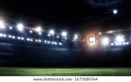 Night football arena in lights close up Royalty-Free Stock Photo #1673680564