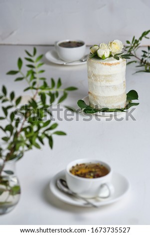 Romantic cake with roses for two. Festive dessert decorated with flowers. #1673735527