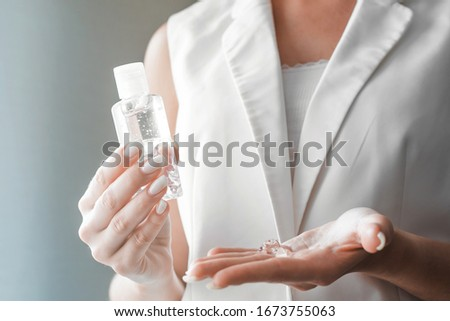 Women washing hands with antibacterial sanitizer gel. Hygiene concept. Prevent the spread of germs and bacteria and avoid infections corona virus. #1673755063