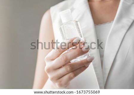 Women washing hands with antibacterial sanitizer gel. Hygiene concept. Prevent the spread of germs and bacteria and avoid infections corona virus. #1673755069