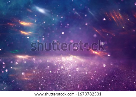 background of abstract glitter lights. gold, blue and purple. de focused Royalty-Free Stock Photo #1673782501