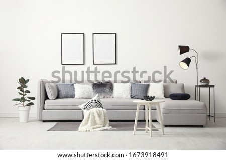 Stylish living room interior with comfortable sofa Royalty-Free Stock Photo #1673918491