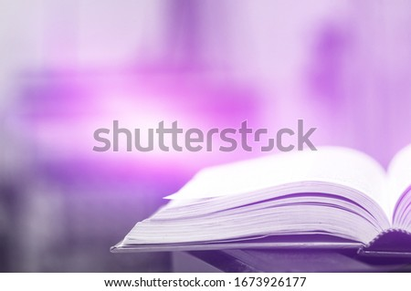 Books magic light with bright shining down background. Imagine picture book concept. knowledge concept learning technology. Education kids books isolated. Opened on wooden table with sparkling golden. #1673926177