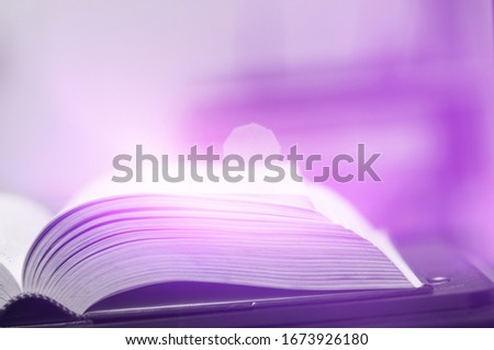 Books magic light with bright shining down background. Imagine picture book concept. knowledge concept learning technology. Education kids books isolated. Opened on wooden table with sparkling golden. #1673926180
