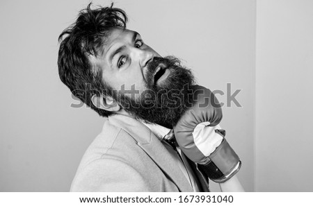 Painful punch. Teeth pain concept. Defenseless head. Suffering. Punch in face. Destroy beauty. Cosmetology and plastic surgery services. Strong punch. Hand in boxing glove punching bearded male face. #1673931040