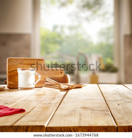 Table background of free space and blurred background of kitchen  #1673944768