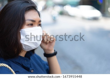 Woman wearing protective face mask at outdoor. #1673955448