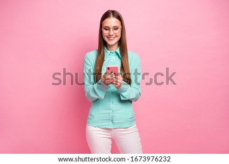 Portrait of positive cheerful girl use smartphone read social network novelty wear good look turquoise outfit isolated over pastel color background #1673976232