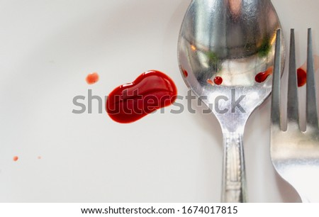 Spoon and fix it with the blood dripping on the white rice plate.