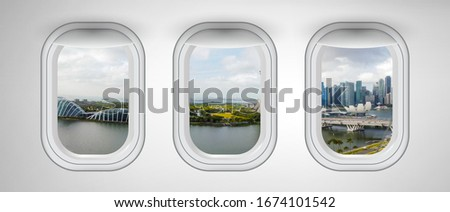 Airplane windows with Singapore skyline view. Travel and holiday abstract concept. #1674101542
