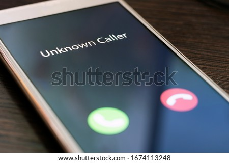 Unknown caller. Smartphone with incoming call from an unknown number at night. Incognito or anonymous #1674113248