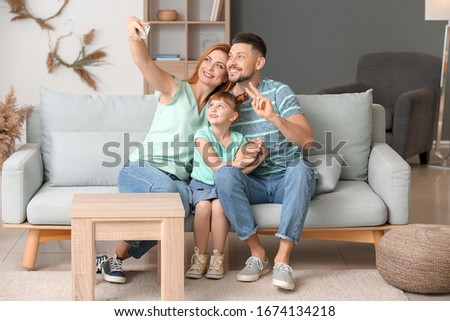 Family taking selfie at home #1674134218