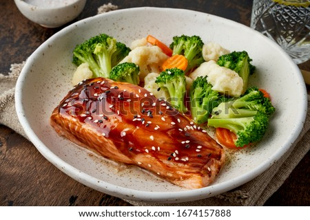 Steam salmon and vegetables, Paleo, keto, fodmap, dash diet. Mediterranean food with steamed fish. Oven baked asian dish with teriyaki. Healthy concept, gluten free, lectine free, top view #1674157888