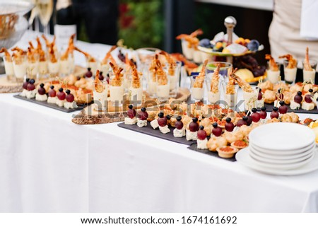 buffet on the street. snacks for the event. organization of holiday #1674161692