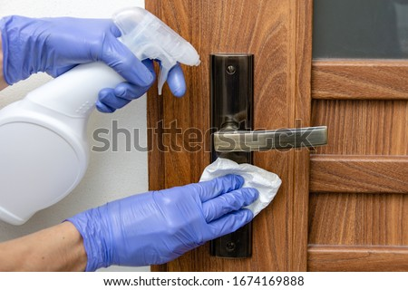Disinfection, cleaning and washing of door handles.  Prevention of coronavirus infection #1674169888