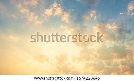 Beautiful Vivid sky painted by the sun leaving bright golden shades.Dense clouds in twilight sky in winter evening.Image of cloud sky on evening time.Evening Vivid  sky with clouds.  #1674223645
