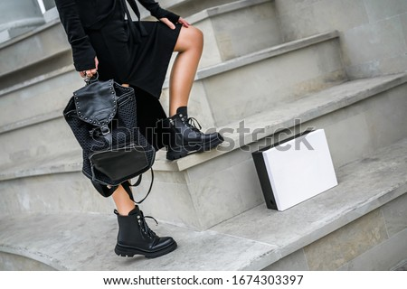 a new collection of women's shoes autumn winter '20 / 21. The girl bought new shoes. Legs in boots. Boots in a box Royalty-Free Stock Photo #1674303397