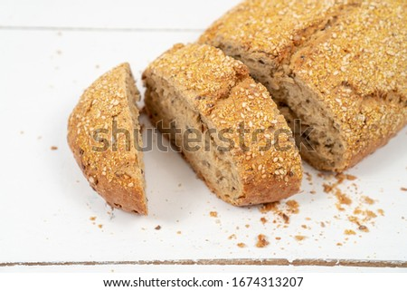 Sliced Bread With Sesame Seeds On The White Wooden Boards #1674313207