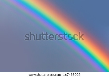 beautiful rainbow in blue sky after the rain