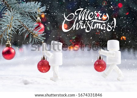 Lettering merry christmas two marshmallow snowman decorate christmas tree by red balls bokeh winter background  #1674331846