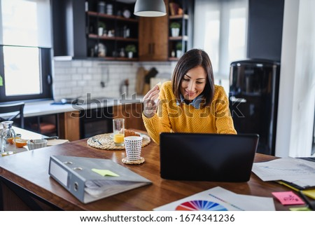Young business entrepreneur woman working at home while having breakfast Royalty-Free Stock Photo #1674341236