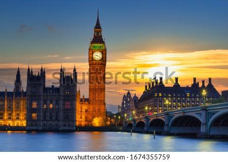 Big Ben and Westminster Bridge in London at sunset, UK Royalty-Free Stock Photo #1674355759
