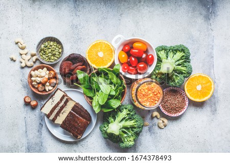 Plant based sources of iron background. Oatmeal, lentils, tofu, broccoli, dried apricots and nuts are iron-rich foods.