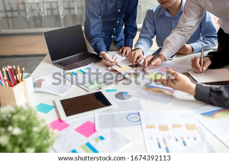 Group of business people working together on new project with planning analytical report at meeting.. #1674392113