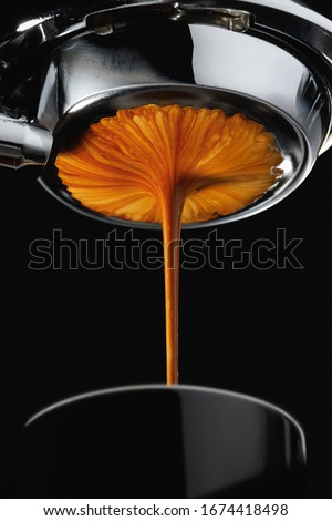 Espresso shot from espresso machine dark background #1674418498