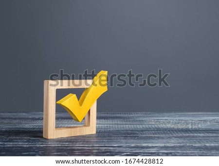 Yellow voting tick in a checkbox. Democratic institutions, vote on democratic elections, referendum. Opinion Poll. Make right choice. Confirmation, passing the test. Verification. Law implementation Royalty-Free Stock Photo #1674428812